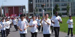 young people carrying Olympic torch